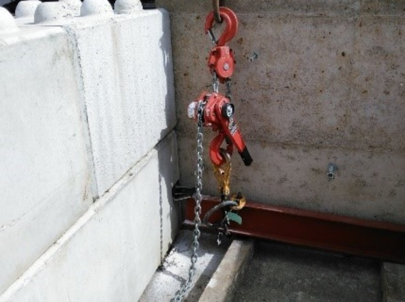 Left - Steel goal-post frames to support doors.                      Right - Bespoke shear test for fixings in sample panel.